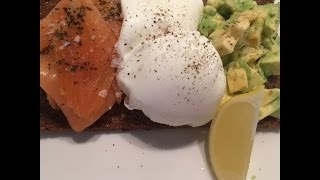 Poached Eggs, Smoked Salmon And Avocado On Toasted Rye Bread