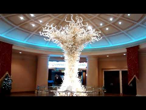Turning stone casino glass tree with it's story