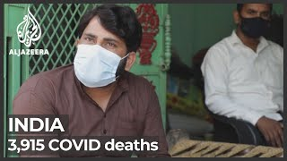Download India's COVID cases rise by record 414,188; deaths swell by 3,915