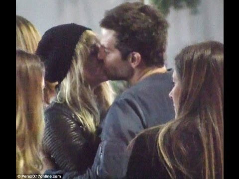 Bradley Cooper and Suki Waterhouse share a kiss