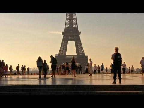 Tourists flock back to Paris a year after terror attacks