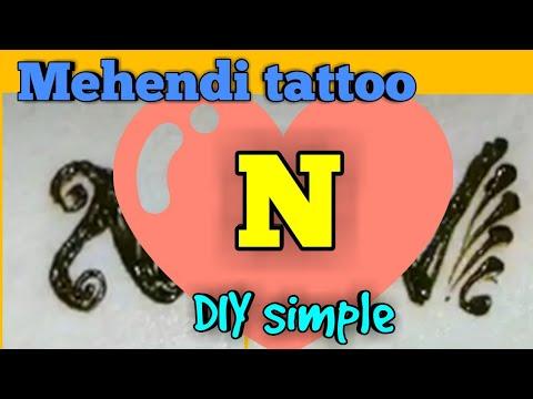 N letter henna mehndi tattoo two designs. Arabic mehndi design. Alphabet N मेहंदी डिजाइन टैटू