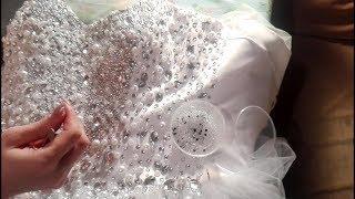 Оформление свадебного платья бисером, камнями, стразами и бусинами. Добавлено