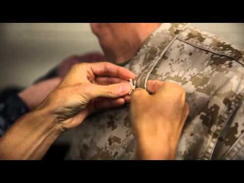 Marine officer gets pinned by Naval brother-in-arms