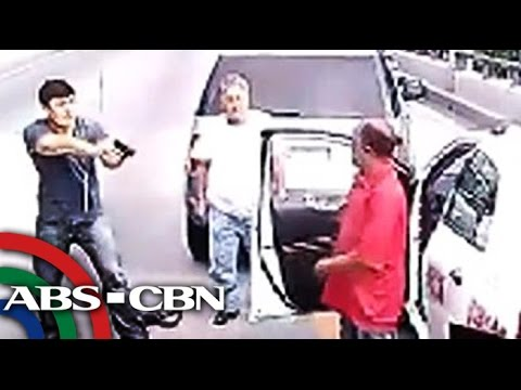 Man points gun on taxi driver in road rage