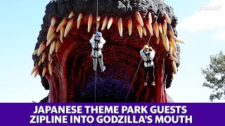 Japanese theme park guests zipline into Godzilla's mouth