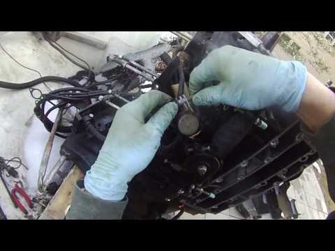 mercury outboard 90hp tear down part 4 - fly wheel removal