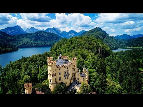 BAVARIA, GERMANY: Beautiful drone flight over the Bavarian countryside (Alps, Neuschwanstein, etc.)