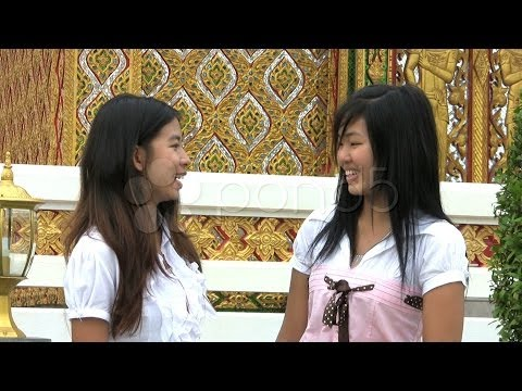 Asia Girls Talking-Cell Phone Interruption. Stock Footage