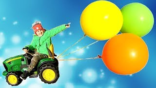 Timko and Papa ride on Toy Tractor with Giant Balloons