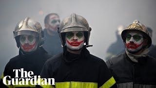 Firefighters clash with riot police in France protests