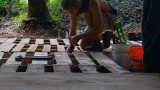 Building a pallet floor at Cinderland