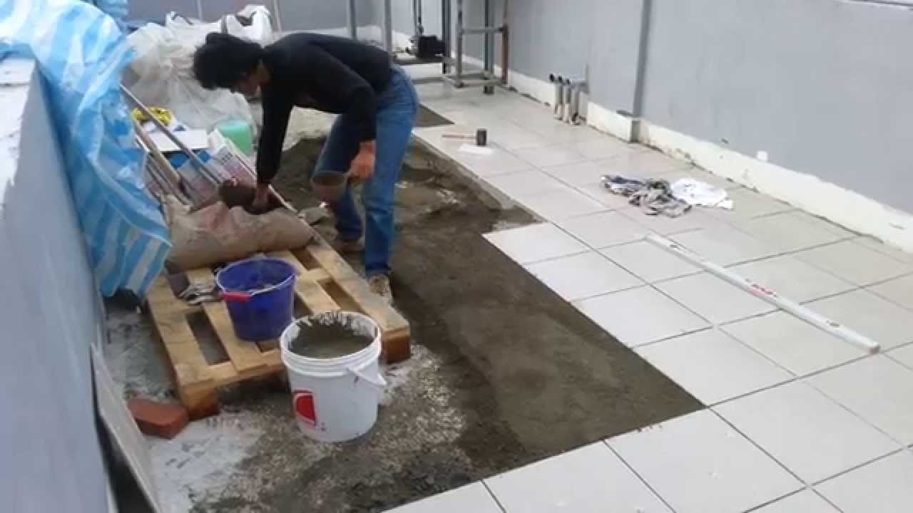 Ceramic floor tile installation with sloping gradient for Ceramic floor installation