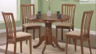 Brannan Oak Round Dining Room Collection From Coaster Furniture