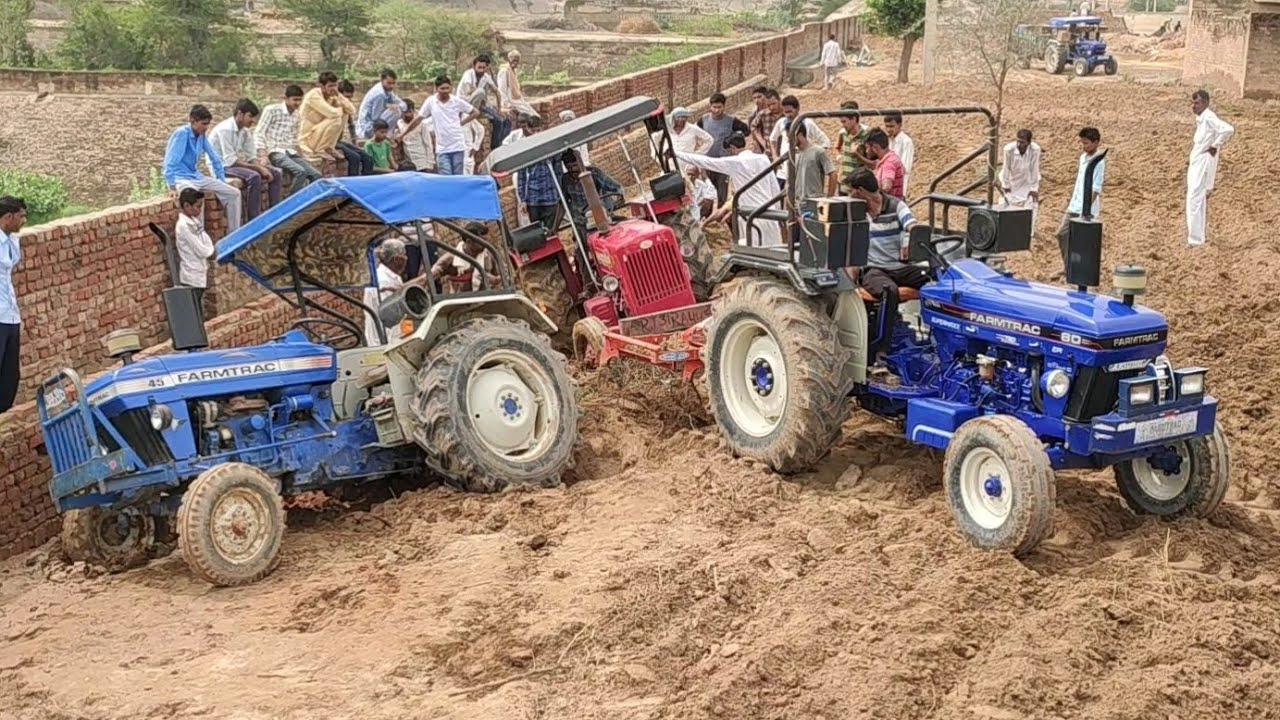 Mahindra 575 tractor stuck in deep mud , Mahindra 575 pulling by Farmtrac 60