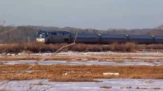 Amtrak Downeaster with 3 P42s flies across frozen Scarborough Marsh
