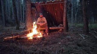 Shelter building in the woods, Cooking over the campfire pasta with  sauce, part #1