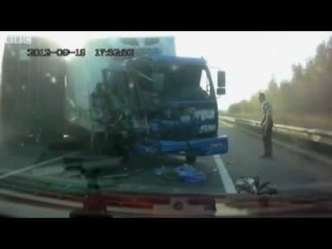 Dash cam captures Russian truck driver's lucky escape from crash