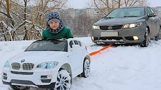 FUNNY BABY Stuck in the SNOW! Kid ride on POWER WHEEL Towing car BMW Funny cars video for kids