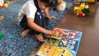 Moksh Plays With Latches Board By Mellisa & Doug