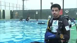 الغواص فيصل الموسوي شاب كويتي يتحدى اعاقته تقرير قناة الجزيرة