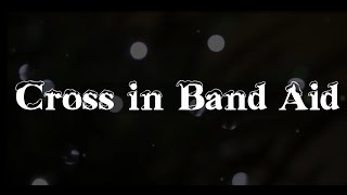 Cross in Band Aid - Feed the World