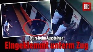 Fahrgäste drücken Zug hoch, um verletzte Frau zu befreien