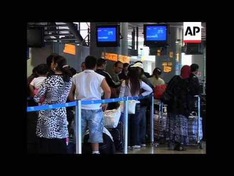 Roma waiting to board plane as they are deported from France