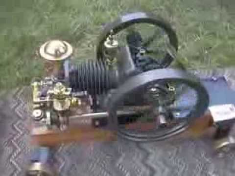 Early Briggs & Stratton converted into Horizontal Sideshaft with flyball governor.