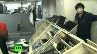 Dramatic footage of TV newsroom violently shaken by 7.4 quake in Japan