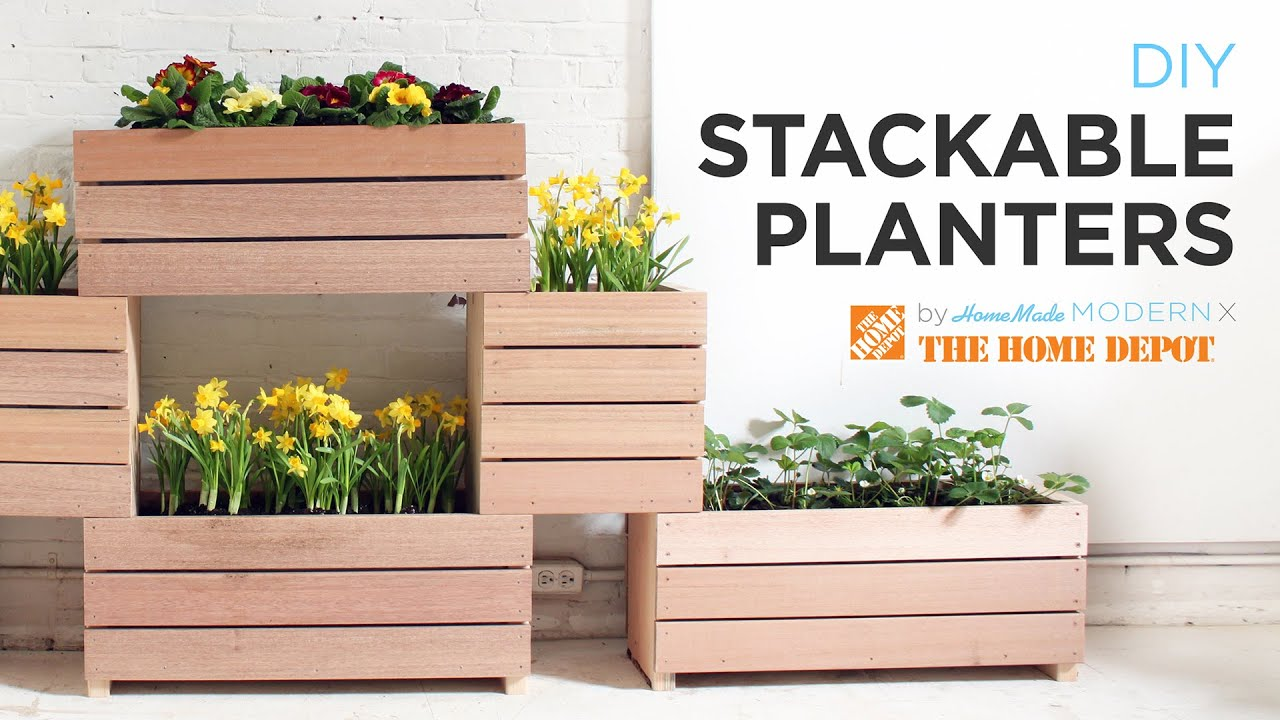 A vertical garden made from diy stackable planters doovi for Vertical garden planters diy