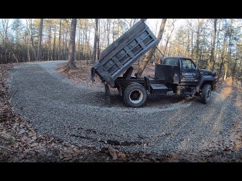 Delivering gravel to a muddy driveway