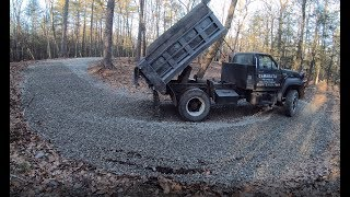 delivering-gravel-to-a-muddy-driveway