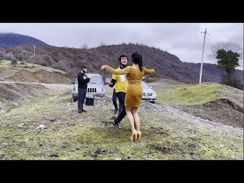 Lezginka dance  with heeled girl on poor surface.