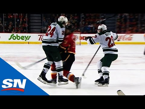 Matt Dumba Takes Out Mikael Backlund With Massive Open Ice Hit To End Game