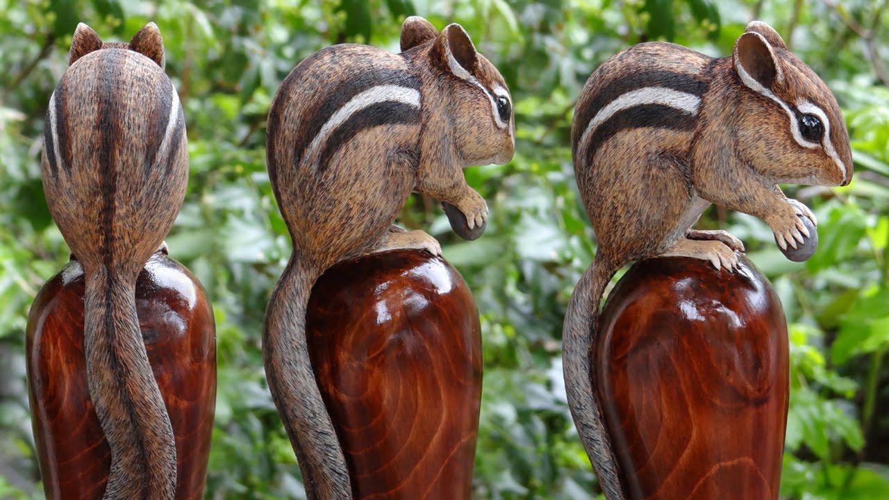Wood carved chipmunk and diamondback rattlesnake walking
