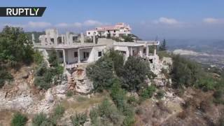 Drone captures devastation of Kinsabba after Syrian govt forces liberate town