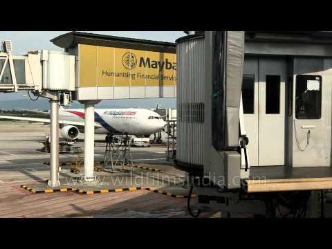 Aerobridge pulls back from Malaysian plane at Kuala Lumpur International Airport, Malaysia