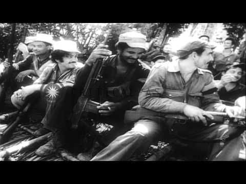 Fidel Castro and his army fight against Batista's forces in Oriente province of C...HD Stock Footage