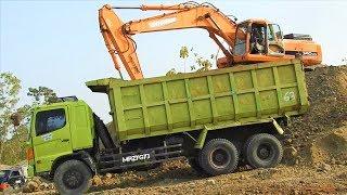 Video still for Excavator Digging Loading Dirt Into Dump Truck On Quarry Doosan 340LCV Kobelco SK200