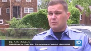Firefighter catches baby thrown out of window during fire