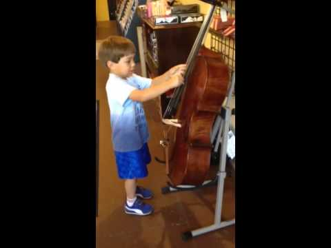 Austin testing a cello at high strung