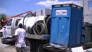 Sewage Waste Truck collects from Porta Potty