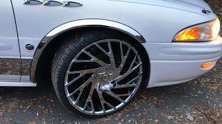 """2004 Buick Lesabre sitting on 22""""Azara-505 wheels wrapped around 265/35-22 Lexani tires."""