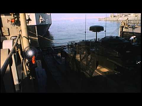 Monitor Flame Boats enter the well deck of USS Catamount and fire streams of flam...HD Stock Footage