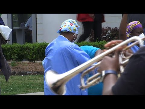 Woman uses her coronavirus stimulus check to pay for second line at New Orleans East Hospital