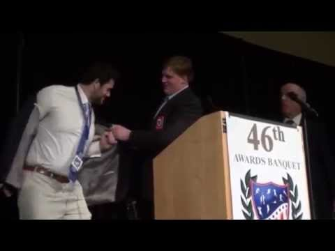 Barrett Jones presents All Sports Association Blazer to Gabe Ikard