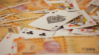 Close up of playing cards with Indian Rupee Banknotes