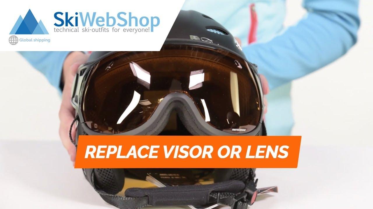 How do I change the lens or visor of my ski helmet?