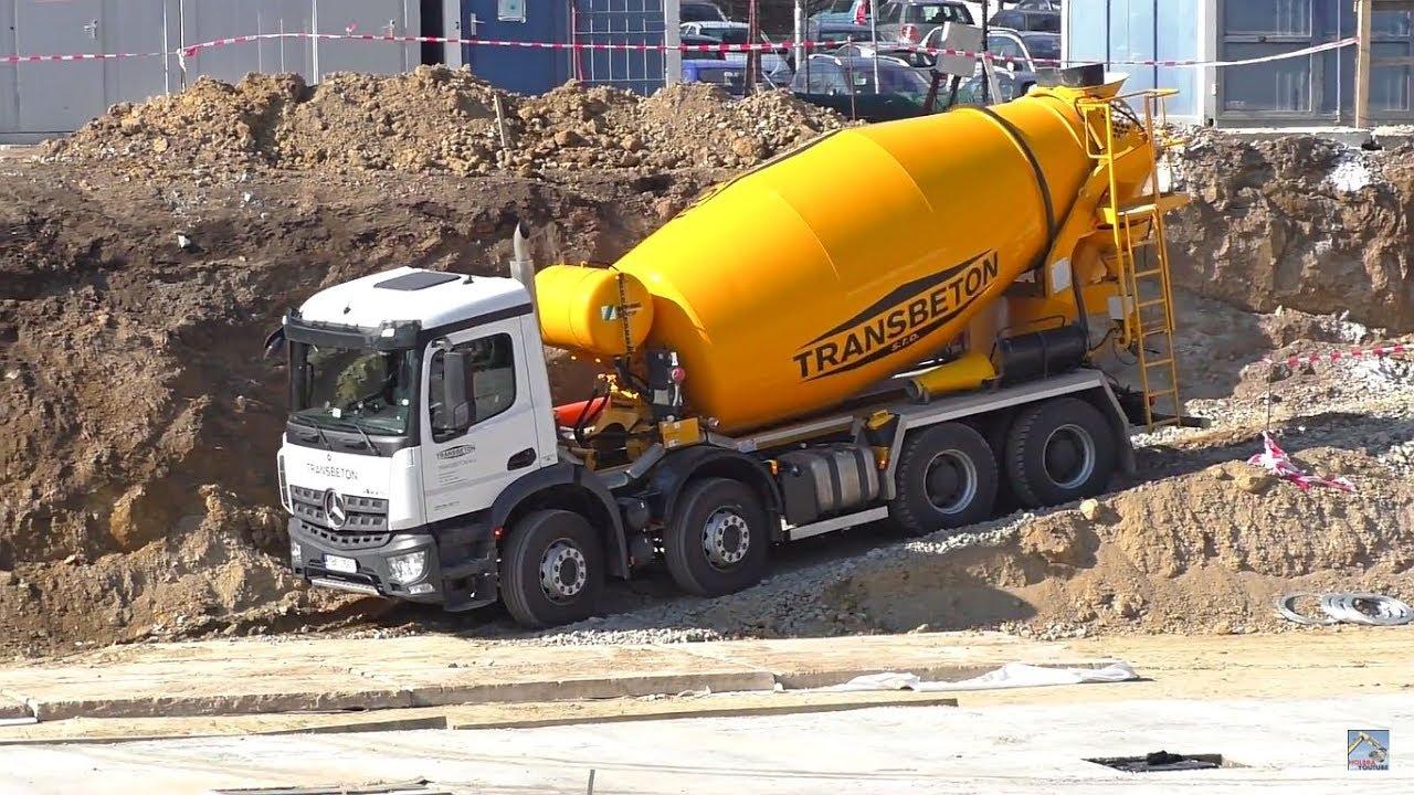 Man and Mercedes concrete trucks work with concrete pump
